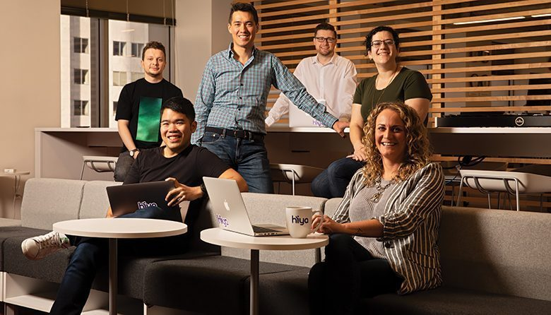 SLAMMING SPAM. Hiya CEO Alex Algard, in the checkered shirt (standing), with, clockwise from left, Misha Bolshakov, Chad Chen, Rob MacKinnon, Hasmik Kalantarian and Michele Osborn.