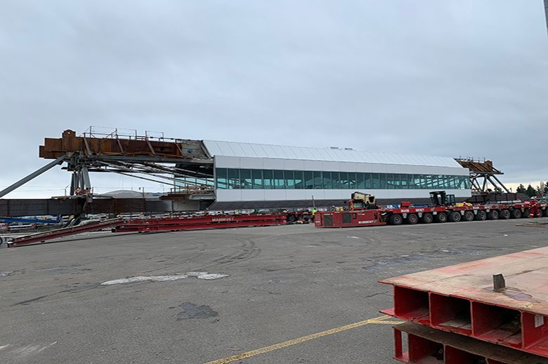 The massive 1,500-ton structure will be transported over a closed runway as part of a highly coordinated late-night operation