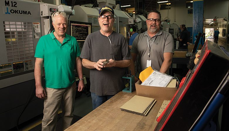 The Lighthouse for the Blind Inc.'s Mike Scheschy, machine shop manager; Mike King, set-up specialist; and Machining Supervisor Duane Stephens are part of a 200-employee workforce that manufactures a range of commercial products.