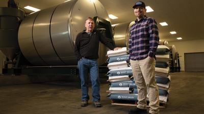 Dave Green, president and CEO, left, and Adam Foy, vice president of business development, are transforming grain into expanding sales at Skagit Valley Malting.